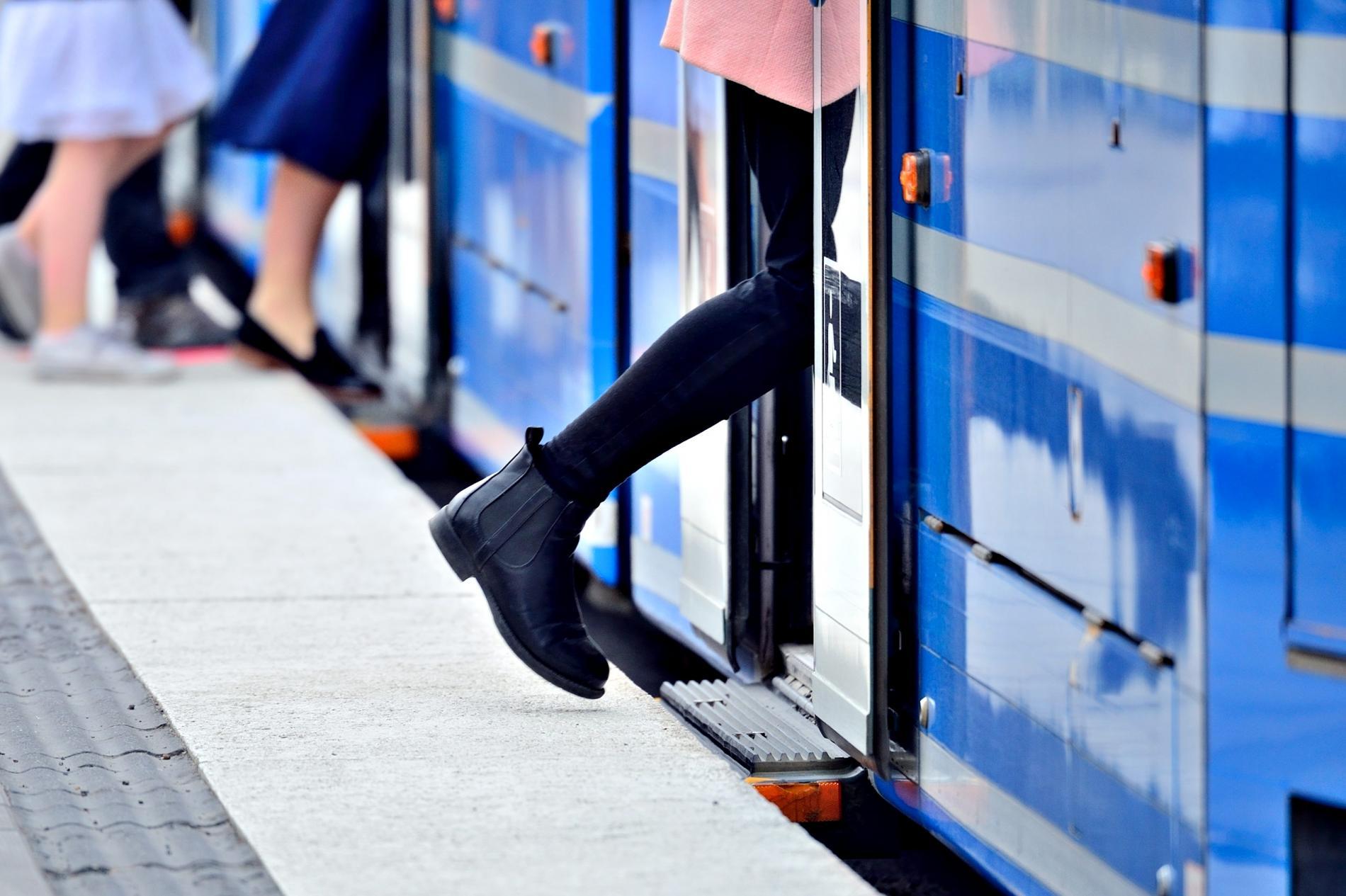 Woman walking in tram