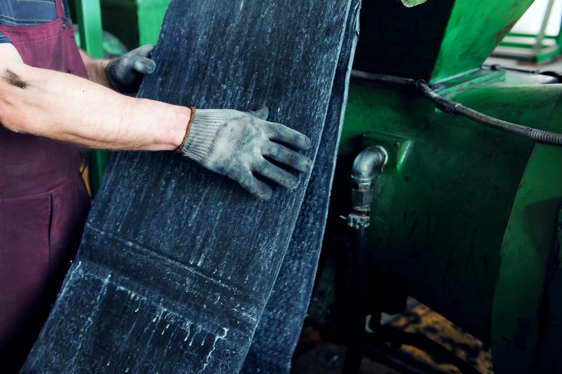 Man holding rubber material